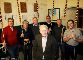 Saved from the bell: John Fowler and his fellow bellringers Steve Beck, Sid Johnson, Pat Rich, Barry Langan, Chris Harvey and Dennis Taylor, who were forced to flee when a 50kg instrument crashed down during practice - Autor: NICOL, Will; SWNS